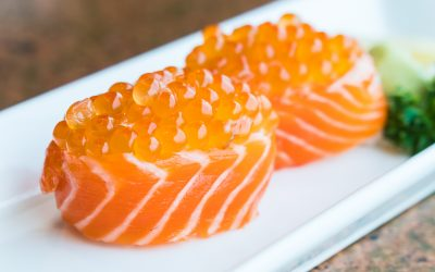 Salmon sushi roll with salmon egg on top - Japanese food style